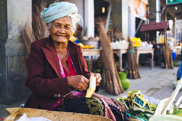 Indonesian lady weaving her daily offereing baskets. Shot on Sony RX1R