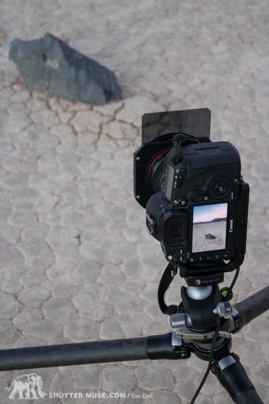 Photographing the mysterious traveling rocks of the Racetrack Playa with a filter holder and graduated ND filter.