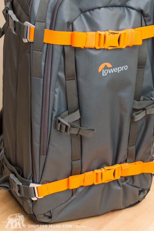 Additional smaller buckles on the front webbing are great for securing poles and ice axe handles. They can be moved around to other areas of the bag to suit.
